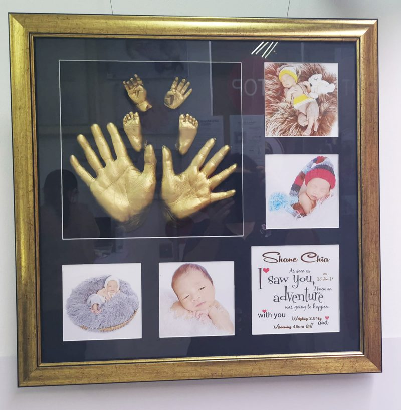 BG8A Parents and baby hands
